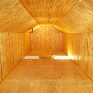 Loft room clad in knotty pine